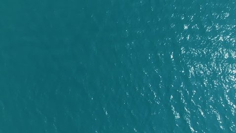 Top view, slow motion. Background of blue sea, blue lagoon with a slight breeze, small wave