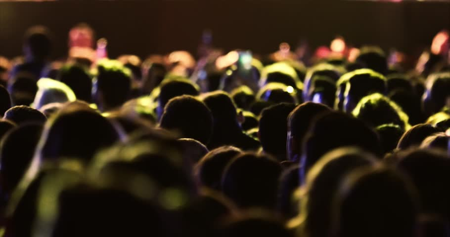 Crowd singing artist cheering, rock music pop music slow music rap music scene shows Concert crowd applause concert stage and concert hall neon Flood led nights club jumping hall waving silhouettes | Shutterstock HD Video #1023393490