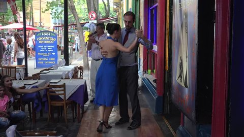 Buenos Aires, - FEBRUARY 24: Tango dancers at a Caminito street cafe of La Boca district. February 24, 2018 in Buenos Aires, Argentina