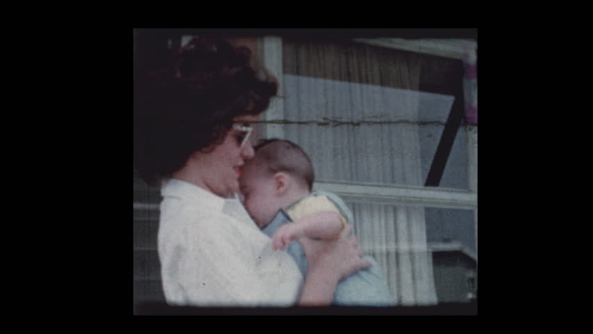 1959 Stylish Women wearing sunglasses holding cute infant baby boy | Shutterstock HD Video #1023437590