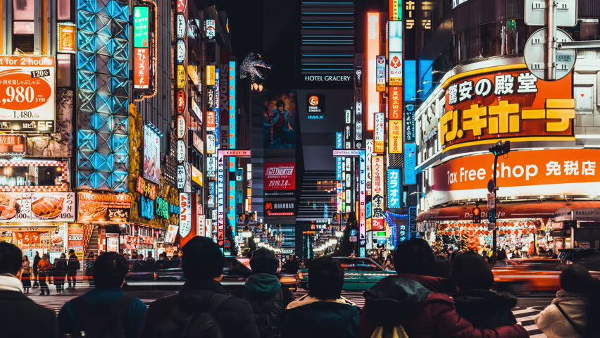 Tokyo, Japan - Jan 11, 2019: Time-lapse of crowded people crossing road, car traffic at Kabukicho, entertainment night life district in Shinjuku Tokyo. Japan tourism or Asia tourist attraction concept