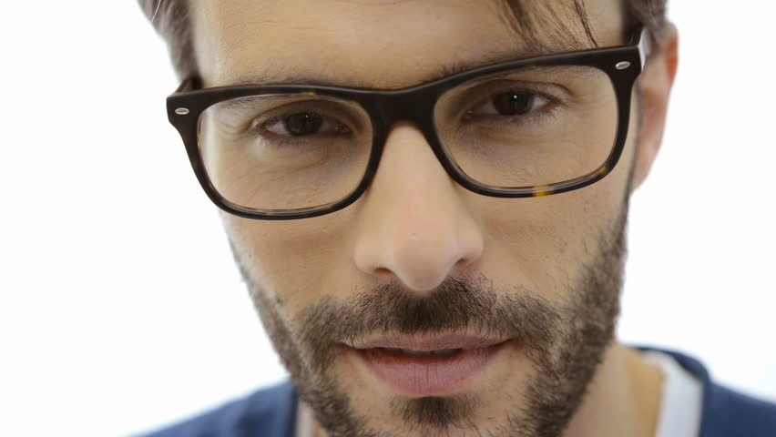 2d258dd8675 Closeup of smiling young man wearing eyeglasses. Portrait of happy guy with  eyeglasses looking at camera. Close up of a serious man with beard looking  at ...