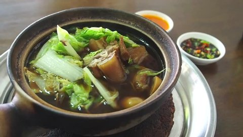 Bak kut teh, a Malaysian broth soup with herbs and spare ribs.