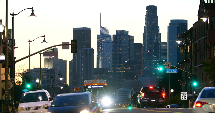 Los Angeles downtown business financial district skyline, skyscrapers and traffic jam congestion at rush hour, California, 4K