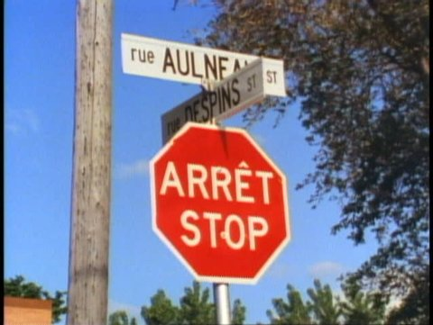 WINNIPEG, MANITOBA, 1990, Stop sign in English (Stop) and French (Arret)