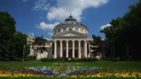 BUCHAREST, ROMANIA - MARCH 26, 2009 Time Lapse of Bucharest with Tourists People Visit Romanian Athenaeum Landmark