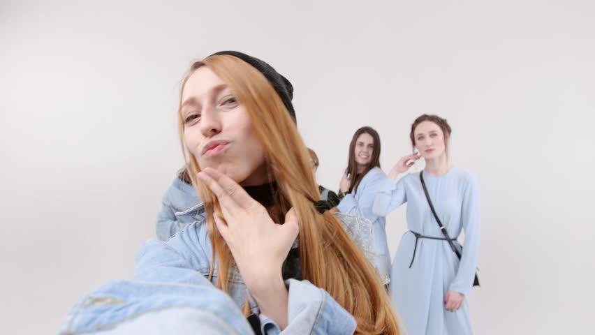 Group of women takes a selfie in the white studio | Shutterstock HD Video #1023586360