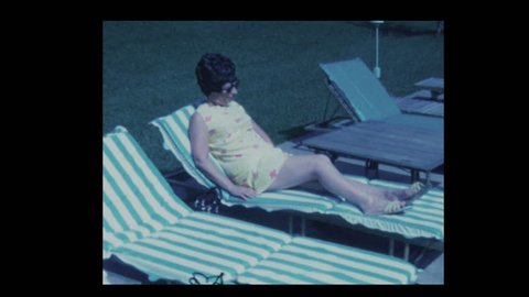 70s woman lounging by pool 1971