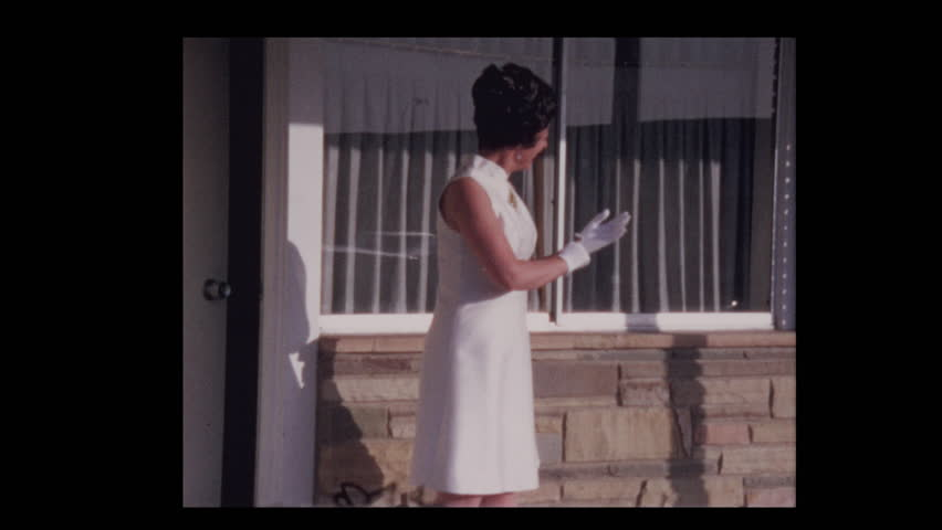 1970 dressed up Couple kiss outside motel room 1971   Shutterstock HD Video #1023594790