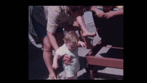 1971 Grandmother teaching happy baby boy grandson how to walk