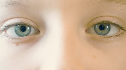 Close up motion of children eyes. Eyes of teenager girl looking up and down, left and right. Eye gymnastics. Ophthalmology and healthy vision. Health care. Parts of face and body. Anatomy human face
