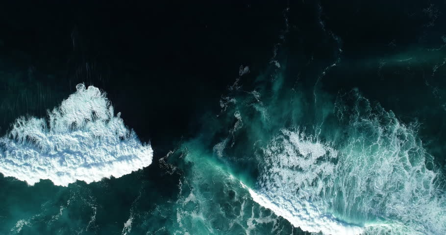 Top down aerial view of giant ocean waves crashing and foaming | Shutterstock HD Video #1023786100
