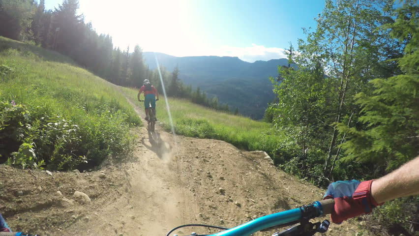 First Person View Of Man Mountain Biking Fast Through Grassy Field And Forest  | Shutterstock HD Video #1023941300