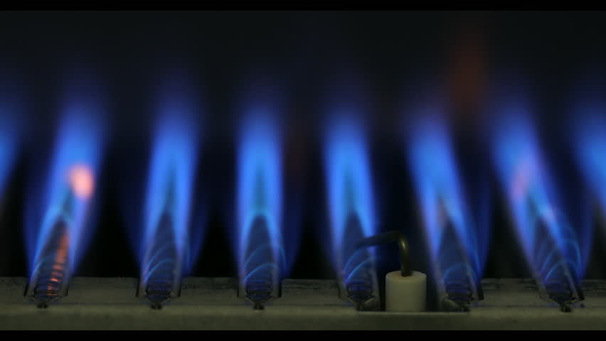 Close-up of ignition and burning of natural gas inside of boiler furnace 4K