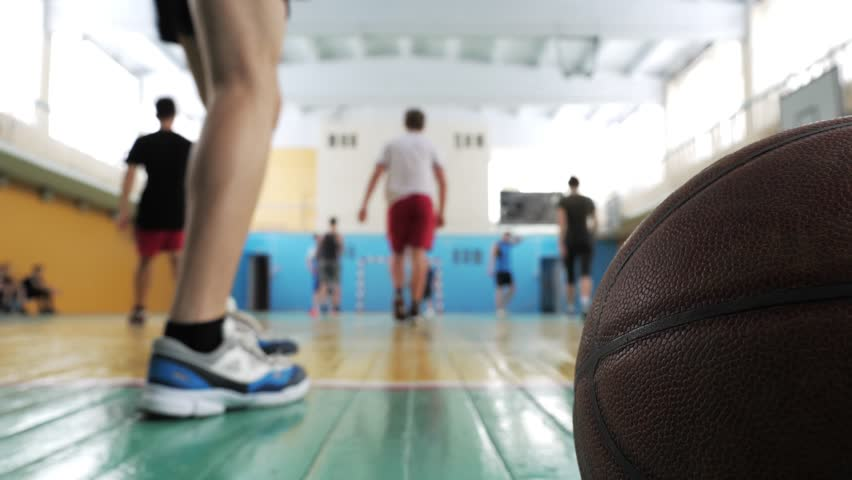 Basketball game. Teens train in the school old sports hall, throw the ball in the basket and run with the ball. | Shutterstock HD Video #1024080470