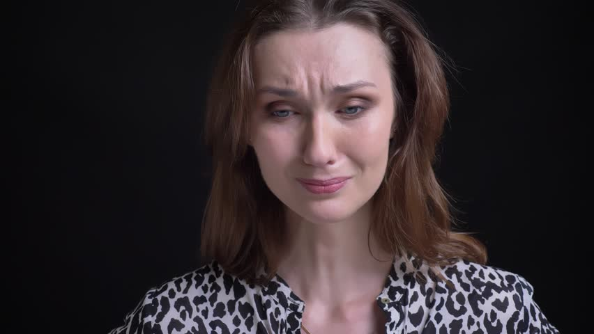 Closeup portrait of young beautiful caucasian female being unhappy and sad while looking at camera | Shutterstock HD Video #1024149200