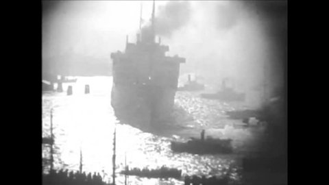 CIRCA 1920s - Black and white footage of a large ship going out to sea in the 1920's