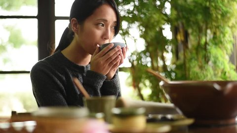 Asian young beauty enjoy the famous Hakka Lei Cha