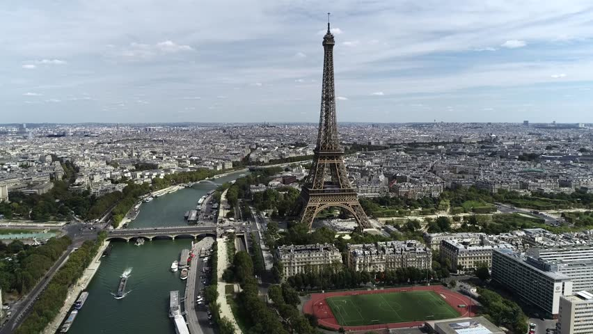 Aerial view of downtown Paris cityscape and Seine River with barge moving over also showing d'Lena bridge and the famous french icon the Eiffel tower one of most popular tourist attractions in Europe | Shutterstock HD Video #1024272800