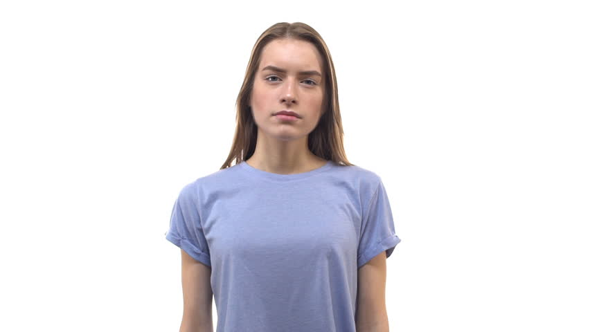 Slow motion worried frustrated attractive young 25s woman run hand through hair frowning complicated, thinking intense, cross arms across chest, worry, head filled doubts, hesitations, sighing hard | Shutterstock HD Video #1024303370