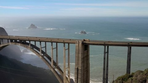 4k Aerial flight over the Bixby Bridge on Big Bur Coastline and Highway One road in California, USA