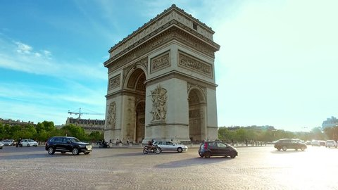 Traffic in front of The Arc de Triomphe de l'Etoile is one of the most famous monuments, hyperlapse cinematic view