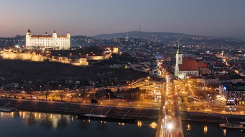 Day to night aerial hyper lapse of Bratislava old town and castle, view from SNP bridge. Slovakia.