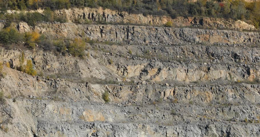 Panorama of a large stone quarry, roads in the quarry | Shutterstock HD Video #1024379180