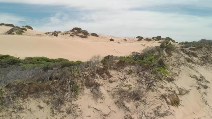 Aerial shot of big sand dunes in Victoria Australia.   Shutterstock HD Video #1024381220