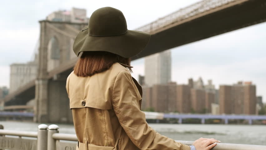 Sensual Woman Waiting For Her Lover On A Date. Stylish Lady Spends Time Near The Bridge. Brooklyn, New York. Floppy Hat Womens.   Shutterstock HD Video #1024391480