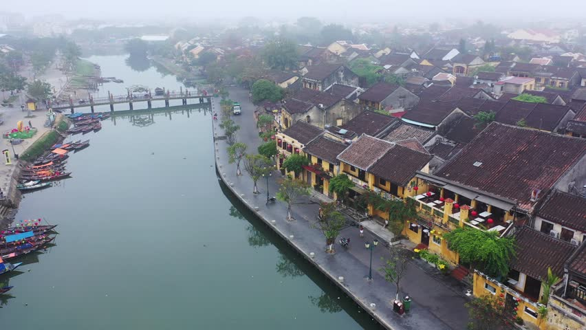 Hoi An, Vietnam: Top view of Hoi An ancient town by fly camera (drone). Hoi An is one of the most popular destinations, UNESCO world heritage, at Quang Nam province, Vietnam. Shooting on 9 Feb, 2019. | Shutterstock HD Video #1024437830