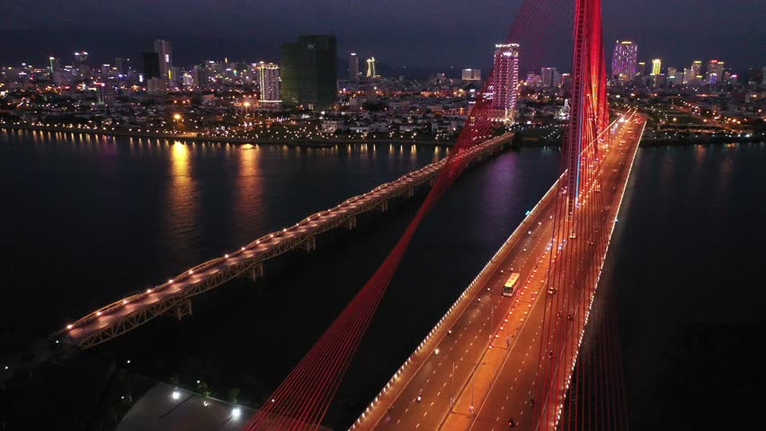 Aerial top view Tran Thi Ly Bridge, Han river in Da Nang City, Vietnam Da Nang city at sunset which is one of the most beautiful place of Vietnam for tourists. | Shutterstock HD Video #1024439090