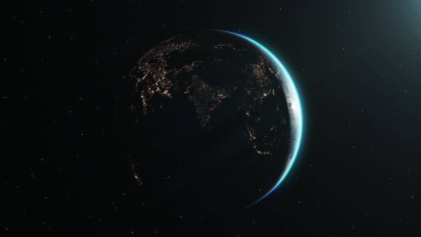 The Earth slowly rotating in space, backlit by the sun with the lights of the planet's cities visible on the surface. The sun drifts across frame as the world turns, revealing the continents at night.