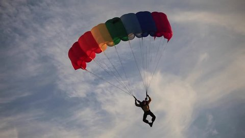 GRODNO, BELARUS: SEPTEMBER 19, 2015:  Man parachuting down at the national city day in Grodno