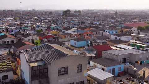 SOUTH AFRICA - CIRCA 2018 - Aerial over Gugulethu, one of the poverty stricken slums, ghetto, or townships of South Africa.