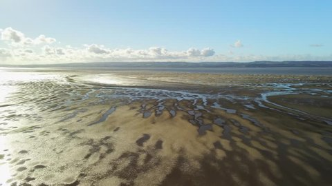 Drone Aerial Push In on a Pattern on an Estuarine Mudflat in Hilbre Island, Wirral UK.