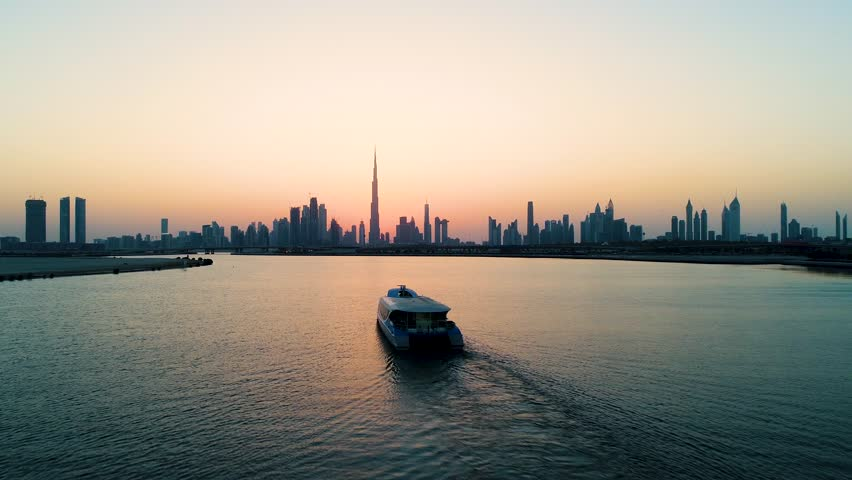 Aerial view of a yacht in the bay of Dubai during sunset, U.A.E.