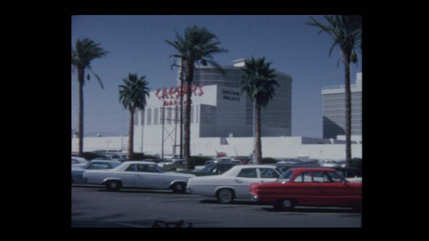 Las Vegas, Nevada, USA- 1970: Las Vegas Strip Hotel Casino signs and vintage cars