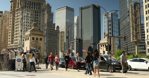 Chicago, Illinois, USA - September 25, 2018: Cars and people walk across the DuSable Bridge over the Chicago River in downtown Chicago Illinois USA during a summer day
