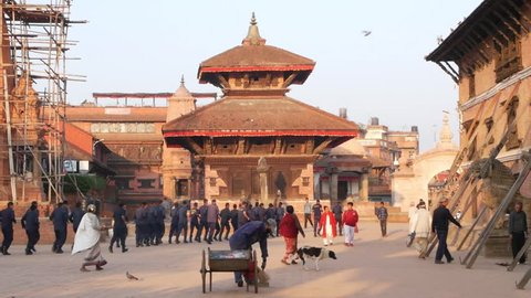 BHAKTAPUR, KATHMANDU, NEPAL - 18 Armed police officers and soldiers wearing uniform training. Communist Party power, maoist policeman security guard. Daily life, oriental ancient city after earthquake