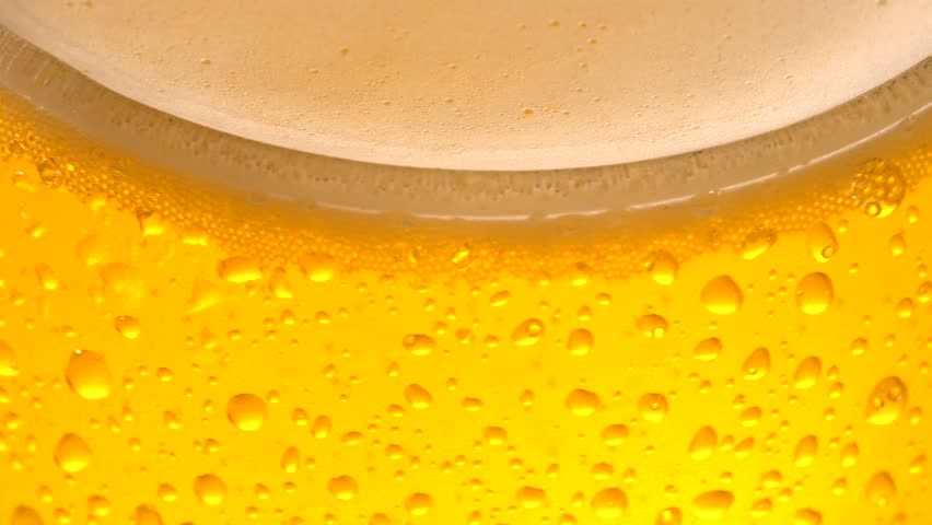 Close up  of cold beer with drops and bubbles. | Shutterstock HD Video #1024835000