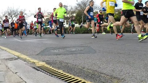 VALENCIA, SPAIN - JANUARY 27, 2019: Runners at the start of the XXI Carrera Popular Galapagos road race in the streets of Valencia, Spain.