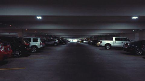 POV drive through underground parking garage in slow motion 120fps