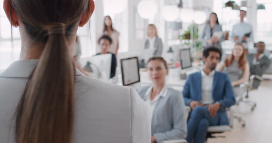 Business woman team leader presenting in office meeting colleagues sharing leadership ideas in office training presentation seminar | Shutterstock HD Video #1024980620