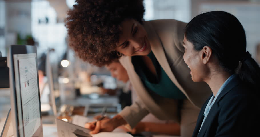 Business people working late using computer team leader woman sharing information with colleague giving feedback discussing solution for project deadline in office at night | Shutterstock HD Video #1024999910