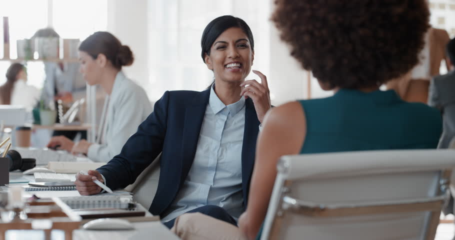 Young indian business woman chatting to intern discussing job interview colleagues having conversation in office enjoying teamwork | Shutterstock HD Video #1025001470