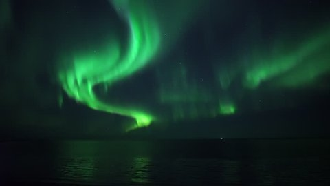 Brilliant real time Aurora Borealis reflecting in ocean real time video Grotta Iceland.mov