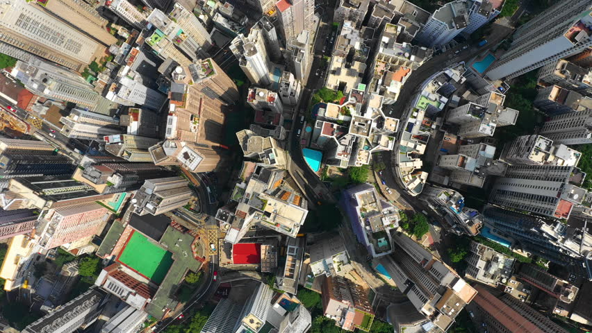 Sunny hong kong city downtown living block traffic streets high aerial topdown panorama 4k | Shutterstock HD Video #1025296370