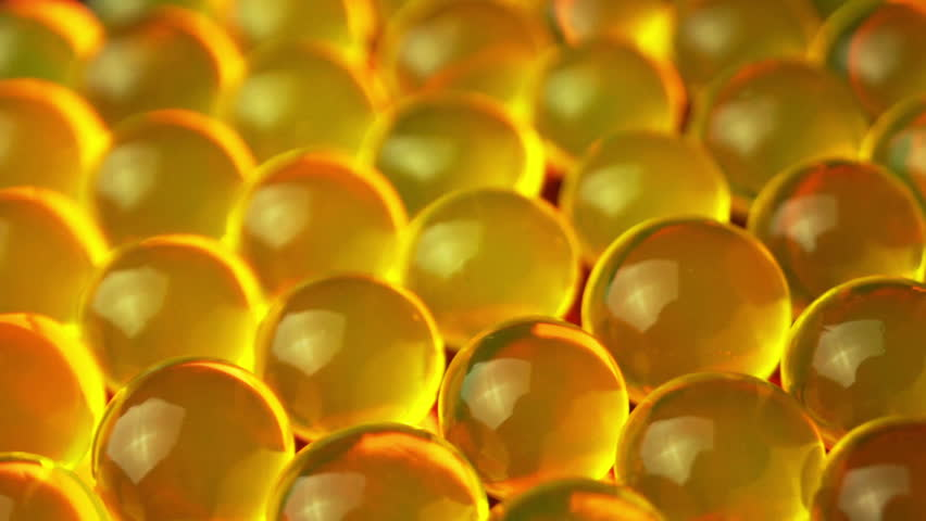 Yellow balls of hydrogel rotate and shine red | Shutterstock HD Video #1025341610