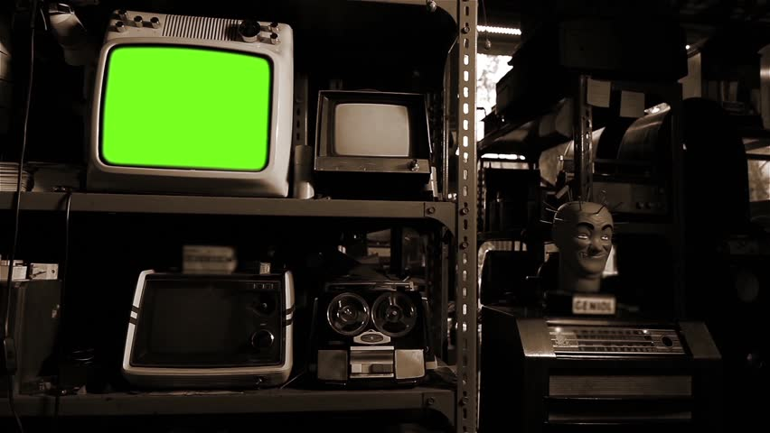 Vintage TV with Green Screen in An Antique Shop. Sepia Tone. Zoom In.    Shutterstock HD Video #1025371460